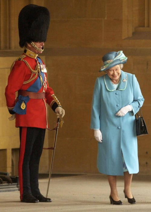 theblackship:  evil-sherlock-holmes:  thesassylorax:  elizabethii:  The Queen breaking into laughter as She passes Her husband, the Duke of Edinburgh, standing outside the Buckingham Palace, 2005  She's adorable.  It's the hat. the hat always gets ya.