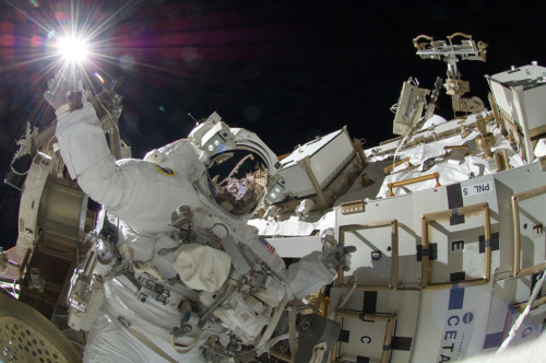 Photo of the day: NASA astronaut Sunita Williams, a flight engineer for Expedition 32, appears to touch the bright sun during a spacewalk mission with Japanese astronaut and flight engineer Aki Hoshide (visible in the reflection of Williams' helmet visor) on the International Space Station. The mission, which lasted for 6.5 hours, completed the installation of a Main Bus Switching Unit that was hampered last week by a possible misalignment and damaged bolt threads.