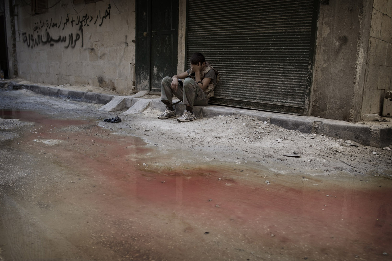 Sept. 2, 2012. A Free Syrian Army fighter rests in exhaustion after heavy fighting in Aleppo, Syria.  From an eruption on the sun and the death of Rev. Sun Myung Moon in South Korea to Redhead Day in the Netherlands and students heading back to school around the world, TIME presents the best images of the week. See more photos here.