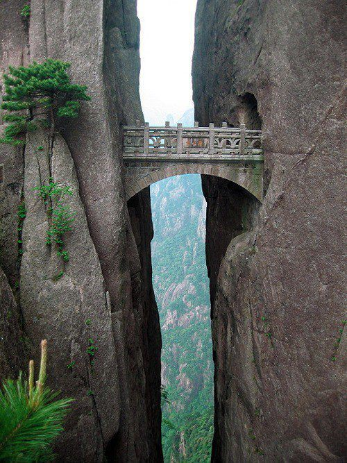 zuky:  comix:   The world's highest bridge, The Bridge Of Immortals, is situated in the Yellow Mountains, also known as Huangshan. From the bridge you will have a breathtaking view, and see how the clouds are touching mountainsides beneath you.  O-O  Huangshan is a magical place. I've been there twice, gazed out across the sea of clouds, and yeah, it's breathtaking. It's considered to be so imbued with intoxicating energy that people are said to have jumped off cliffs believing they could fly. If you go there, I suggest keeping your feet firmly on the ground.