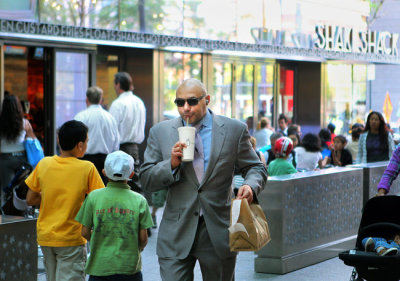 Goldman Sachs employee enjoying Shake Shack on the go…Battery Park City, NY (via NY Times)