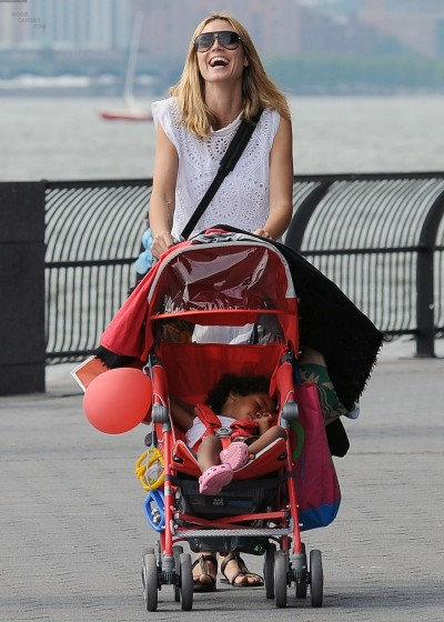 Heidi takes her kids for a stroll through Battery Park…New York, NY (via Model Candids)