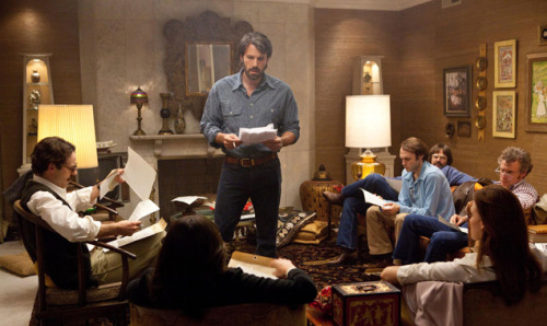 Toronto Film Festival: Tom Carson reviews Argo Tom Carson reviews Argo, Ben Affleck's take on the 1979 Iran hostage crisis:  It's a safe bet that Ben Affleck, who directed and stars in Argo, didn't conceive the movie as a salute to American-Canadian relations. But seeing it on my first day here in ever-lovely Toronto added an extra bounce to this nifty and suspenseful blend of Carter-era grit and La-La-Land uproariousness, since Argo does feature a heroic Canadian ambassador (Victor Garber) who successfully hid a half-dozen understandably rattled U.S. embassy employees inside his Teheran official residence, during the 1979 hostage crisis. It's not like our northern brethren rate too many tributes at festival time even from their own filmmakers—who, at their most patriotic, are a lot likelier to opt for either glum or devilishly puckish resignation about being the Other White-Meat Country instead. But that said, the true story from which the movie derives seesawed between grim and zany in ways that might make plenty of directors more seasoned than Affleck give up on finding the right tone. When protesters stormed our Tehran diplomatic compound and took 59 Americans hostage to retaliate for Jimmy Carter granting asylum to the deposed Shah of Iran, launching the 444-day ordeal that doomed Whatsisname's presidency and put Ronald Reagan—him, you remember, right, kids?—in the White House, one group of junior employees from the embassy's consular section managed to find refuge with Canadian envoy Ken Taylor. (Argo actually skips over a lot of the hair-raising time they had getting to him.) Once alerted to their whereabouts, the CIA hatched various schemes to sneak them out of the country in one piece; the nuttiest was exfiltration expert Tony Mendez's notion of disguising them as a film company scouting locations for a terrible Star Wars rip-off named Argo. Of course, that's the one that worked.  Read the full review here.