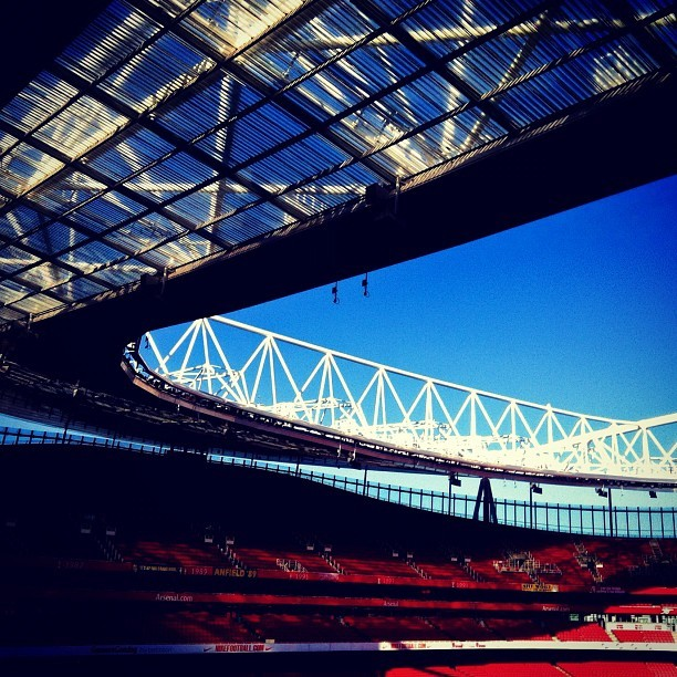 #arsenal #football #stadium #grounds #sky #blue #london #roof #architecture #stand #bars #metal #sun #emirates #emiratesstadium  (Taken with Instagram)