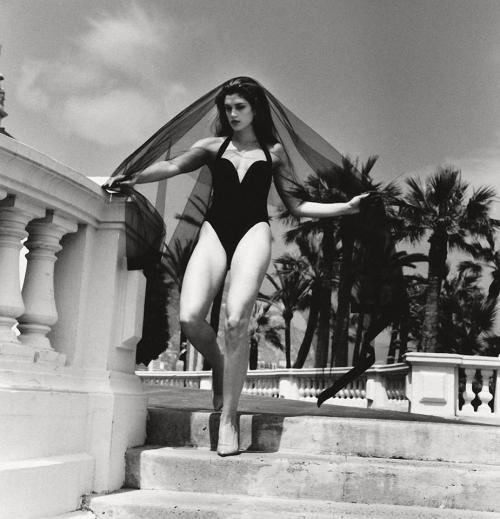 "80s-90s-supermodels:  I always loved working with Helmut Newton. He was a great storyteller and had a wicked sense of humor. This is from a shoot I did with Helmut in Monaco for American Vogue. As we were doing this photo, Helmut said, ""you are a widow…, your husband just died…, he left you a lot of money…,you have a young lover… He wanted to see how you took in what he was saying and how you could espress it on your face."