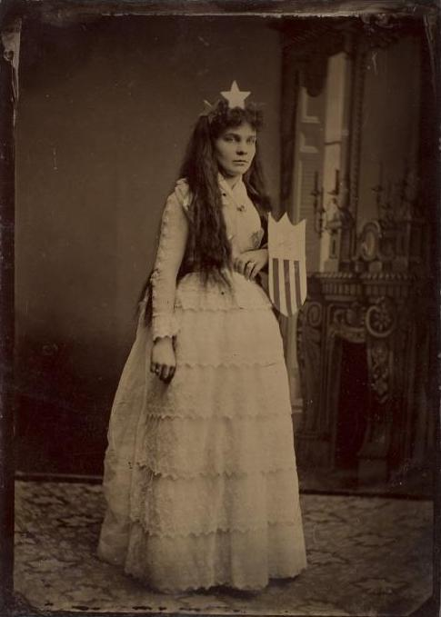 ca. 1875, [tintype portrait of a woman dressed, possibly as Columbia, in a tiara with the Union shield] via the International Center of Photography