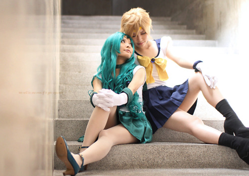 [Image:  A photograph of two women in Sailor Neptune and Sailor Uranus cosplay's, lounging on a set of stone steps.  The Sailor Neptune cosplayer is looking up fondly to the Sailor Uranus cosplayer.] girlsbydaylight:  by M2光樹