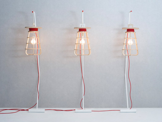 Oversized industrial cage lights in upscale materials by Seung-Yong Song.
