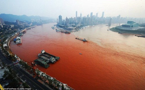 the Yangtze river, which runs through the city in south-western China, turned a bright shade of orange-red yesterday. The waterway where the Yangtze met the Jialin River provided a fascinating contrast as the red started to filter into the other river. (via The river that DID run red: Residents of Chinese city left baffled after Yangtze turns scarlet | Mail Online) Last December, the Jian River in the city of Luoyang, in the north Henan province, turned red after becoming polluted by a powerful dye. The dye was being dumped into the city's storm drain network by two illegal dye workshops. Officials raided the factories to shut them down, and then disassembled their machinery. According to chapter 16, verse 4 of the Bible's book of Revelations, one of the signs that Armageddon is near will be an angel pouring a bowl into the rivers, turning them into blood.