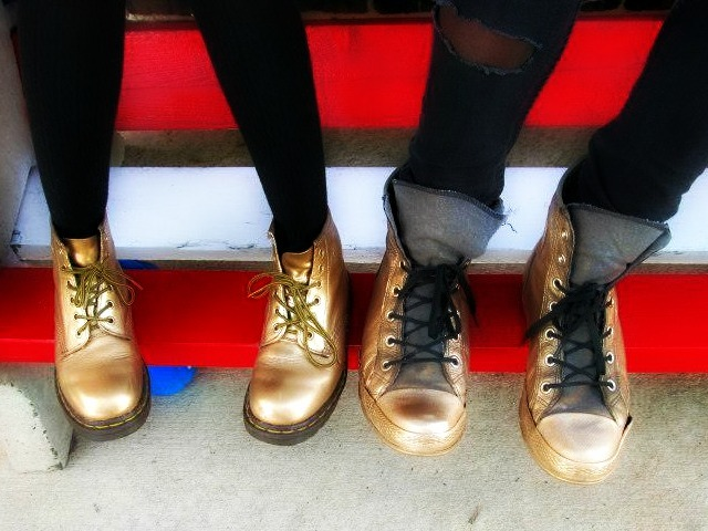 nowayno:  me and christines boots that i spray painted gold