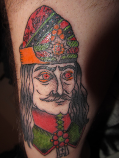 Done by Trevor at Falcon's Tattoo in Columbus, GA. This is my Vlad the Impaler tattoo. I am a huge fan of bram stoker's dracula, as well as the awesome reputation Vlad himself acquired, and I just finished reading Salem's Lot… So when I went in for a whim tattoo, this happened. I think Trevor did a great job. I found the flash online, a deviantartist who goes by PeggySue13.