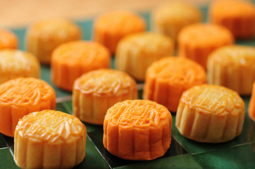Mooncake Mooncakes (月饼, Yuèbǐng) are pastries eaten on the Mid-Autumn Festival, which occurs on the fifteenth of the eighth month on the Chinese calendar, which is on the 30th of September this year. Traditional mooncakes come in a variety of fillings, like white lotus seed paste, red bean paste, and five kernel—most of which traditionally contain at least one salted duck egg yolk in the middle. The history of the pastry dates back to the Yuan Dynasty (1280-1368 A.D.), when the Mongolians ruled China. To spread the word of a rebellion against the foreign rulers, special cakes were made with messages hidden inside. On the night of the festival, the rebels attacked and successfully overthrew the government. The mooncakes are eaten to commemorate this legend.
