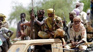 "'Dozens killed' as Sudan's army and rebels clash Sudan's army and rebels say they have clashed on two fronts, reportedly leaving dozens of people dead. The army says it killed 32 insurgents who attacked a village in the western Darfur region. The rebels claim they drove government troops out. Separately, Khartoum says 45 rebels were killed in a village in South Kordofan, near South Sudan's border. The Justice and Equality Movement (JEM) rebels said they liberated the village, killing at least one soldier. Casualty claims in the fighting, which happened on Thursday, have not been independently verified because of restricted access to both Darfur and South Kordofan. Last year, rebel groups in the two states and also in Blue Nile state formed an alliance with the aim of toppling the government of President Omar al-Bashir. Khartoum accuses South Sudan of backing the insurgents. The government in Juba denies the charge, in turn blaming its northern neighbour of backing rebel groups in the South. The latest fighting comes as the US has warned of an ""outright conflict"" between Sudan and South Sudan over a prolonged border dispute. The comments were made on by the US ambassador to the UN, Susan Rice, following a meeting of the Security Council to discuss the issue. South Sudan has accepted a border roadmap proposed by the African Union, but Sudan is refusing to do so. The original 2 August deadline set by the UN failed to produce an agreement. However, both sides are being kept under pressure to clinch a deal by a new deadline - 22 September. Pictured: Darfur rebels say they forced Sudan's army out of a village"