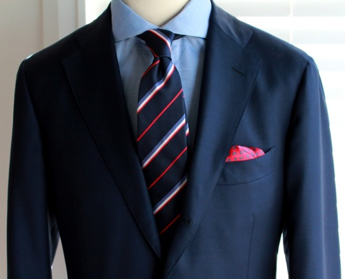 Now in store and perfect for business…Navy repp stripe 7 fold. Self tipped & hand made in Naples. $99.95 AUD.Red w/ navy teardrops printed silk pocket square. Hand made in Naples with hand rolled edges. $39.95 AUDLight blue cutaway collar shirt coming in October.