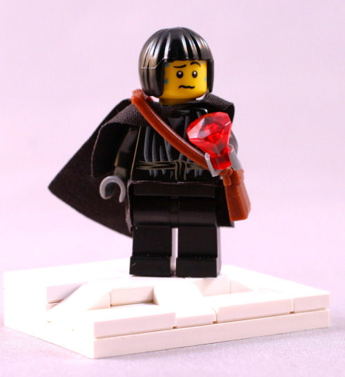 Samwell Tarly.  Currently I don't think there's any obsidian colored Lego gemstones (its a shame), so the red color is more symbolic of dragonglass than representational.