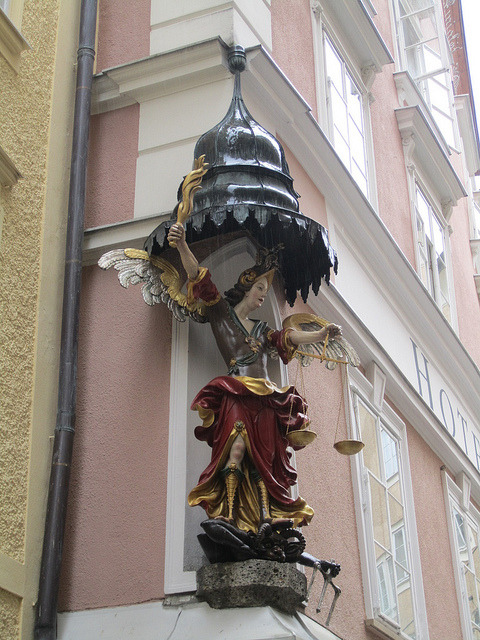 visitheworld:  Corner sculpture on Hotel Altstadt in Salzburg, Austria (by Paul McClure DC).