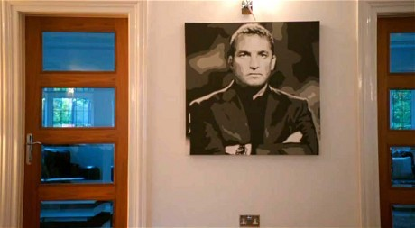 Brendan Rodgers has… a painting of Brendan Rodgers in his home.  Thank you Being: Liverpool.