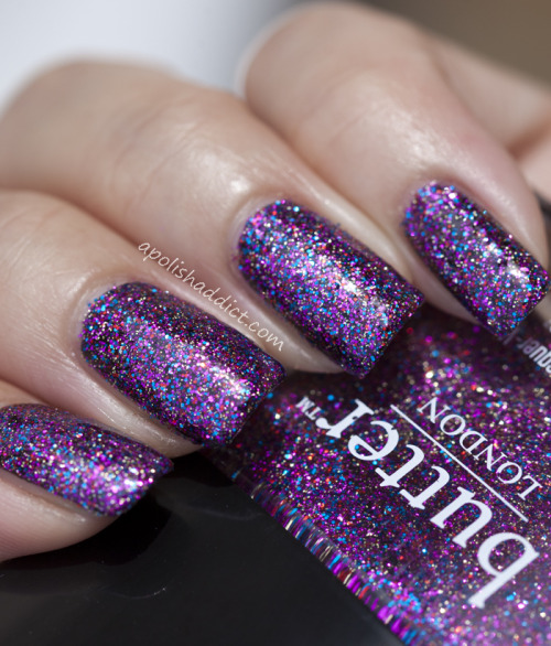 "Butter London ""Lovely Jubbly"" over black — magenta, red, gold and blue glitters make for one colorful glitterfest!  (via Butter London Lovely Jubbly 