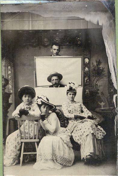 ca. 1890's, [tintype portrait of three women and two men, one poking his head out from behind a photographer's light screens] via Christopher Wahren Fine Photographs, Skylight Gallery #34