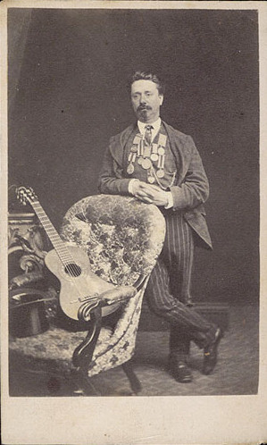 ca. 1870's, [carte de visite portrait of a dashing bemedaled man with guitar] via Christopher Wahren Fine Photographs, Skylight Gallery #34