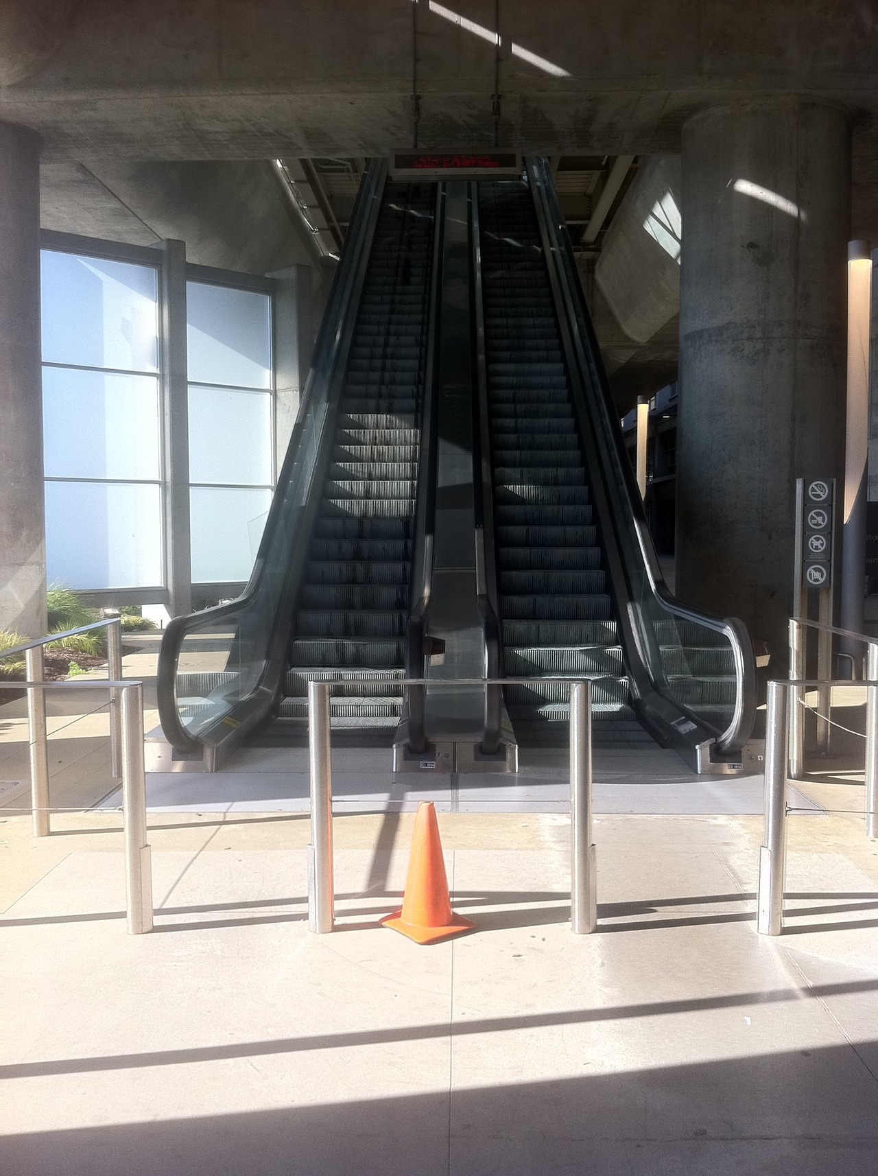 "No one's around, debating whether to try going up the ""down"" escalator."