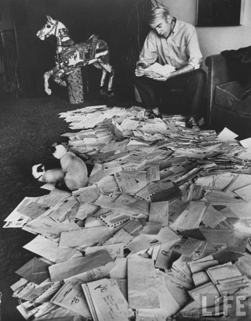 Poet Rod McKuen scanning fan mail at home. Photograph by Ralph Crane, 1967. Source: LIFE Photo Archive, hosted by Google.