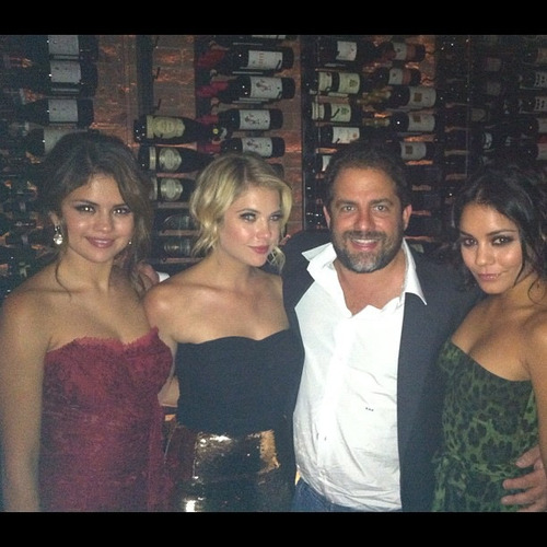 Selena Gomez, Ashley Benson, and Vanessa Hudgens pose for a photo with Brett Ranter at the Spring Breakers Premiere after party.