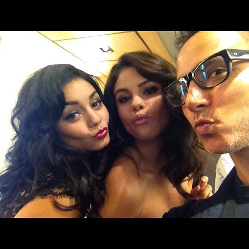 Vanessa Hudgens & Selena Gomez pose with a photo.