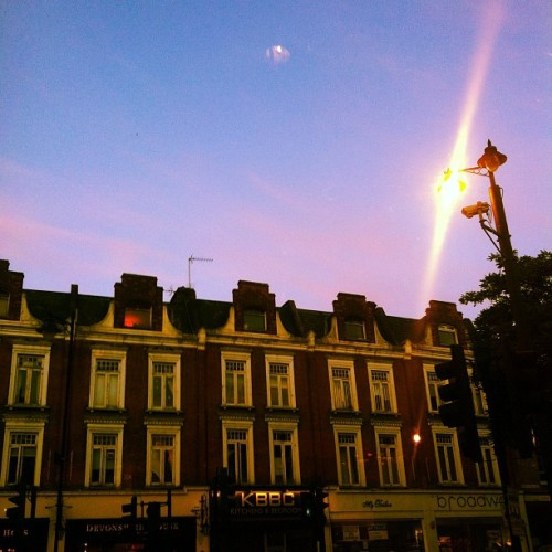 #dusk in #crouchend #sundown #buildings #sky #shops #lamp (Taken with Instagram at Crouch End Broadway)