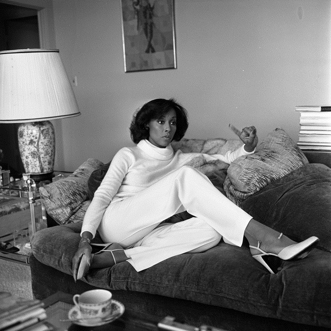 "Dominique Deveraux aka Diahann Carroll | 1979Actress Diahann Carroll holding court in her living room discussing the plight of Blacks in the television industry. Quote, ""For some reason, whenever black skin is on television, everyone relates to it as if it's a documentary."""