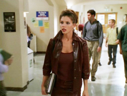 "One of my favorite episodes of Buffy the Vampire Slayer is the season three entry ""The Wish."" In this episode, social queen bee Cordelia returns to Sunnydale High after being impaled by a wayward spike of rebar, but even worse, after being cheated on by her unpopular boyfriend. But even though getting dumped by a social pariah is about the most humiliating thing she could bear, she walks into the hallways with her head held high and wearing her version of the late '90s power suit: a oxblood leather pencil skirt and jacket, complemented with thick brown eyeliner, a spiky updo, and brown-red lipstick. The look is incredibly severe and wildly dated. Except it's not any more. Because guys, oxblood leather? That is so fucking on-trend right now. According to what every fashion magazine is telling me, Cordelia's leather get-up in ""The Wish"" is the ultimate ensemble to kick off the fall season. And the worst part is, even though I still think the look is laughable, I know that as I'm barraged with images and articles, my eyes and brain will eventually adjust and accept its chicness. Two months from now, you'll probably find me scouring the racks at Opitz Outlet muttering, ""There has just got to be an oxblood leather skirt suit around here somewhere!"" This is a depressing reminder of just how malleable taste is. Sure, you will probably always have personal favorites, as well as items that you will forever loathe. But when it comes to trends, it's amazing how much our tastes can change in a matter of seasons, if not months. I remember talking to my friend Mike in elementary school, and we were discussing how oversized sweatshirts and sweaters over leggings or stirrup pants were always going to be the ""in"" thing for girls. And, wow, could you imagine switching the proportions around? Tight tops and big pants? Ridiculous! We laughed out loud at the absurdity of such a look. Smash cut to 13-year-old Beth at a Warren G concert wearing a black bodysuit and jeans so baggy and low-slung on my hips that you could actually see the top of my bodysuit's leg openings. I've never liked cold shoulder tops (blouses with shoulder cut-outs), but as stylist celebrities and off-duty models are photographed pulling them off more and more, will I eventually give in? What if by the time this column is published I'm wearing a damn cold shoulder top?! What does that say about me as a person? So how do you tell the difference between what you actually like and what you've been programmed to like? How do you know if something has finally grown on you or if you've just caved to the constant brainwashing? Is this further evidence that we're nothing more than media sponges, soaking up ads and waiting to be told what to wear, where to go, and whom to listen to? I mean, I know advertising works on me. I always buy the toilet paper with the little puppy on the packaging because I'm afraid that if I don't, the puppy will die. In a puppy mill. I don't know what our fashion future holds. For all we know, next year we'll be hanging out in Starter jerseys under pinstripe overalls, wearing raver Dr. Seuss hats and trucker caps over our frosted permed hair and mall bangs, debating the style and podiatric merits of Uggs vs. Crocs. Anything could happen. In an effort to convince myself that I'm not a product of an army of focus groups, but instead a free-thinking solipsist who believes that the world is nothing but a collection of my own perceptions, I've been thinking about fashion trends that I've always liked. No matter the season. No matter the decade. So here they are, my timeless classics: Black. Leather. Jeans. Rock Tees. Checkered Vans. Combat boots. Sequins. A poufy party dress. Beyond that, I'm nothing more than a slave to fashion. - Beth Hammarlund"