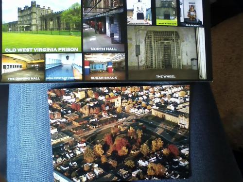 my trip to West Virginia today. top post card is from the West Virginia Penitentiary the bottom is the Grave Creek Mound. Which is one of the largest Indian burial grounds. and yay WV made 27 states that i've been to. 23 more to go!!