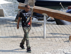 Jay-Z ended his family holiday in style; wearing a tee from the Givenchy spring/summer 2013 collection, army camouflage trousers, and his trademark pair of Air Yeezy II kicks.