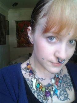 Someone asked for a picture showing all my piercings so here you go! My face looks stupid and so does my hair but you get the point.