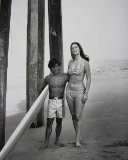 1965, Hermosa Beach, CA, Donald Takayama & Bettina Brenna.  –Photograph by ©LeRoy Grannis