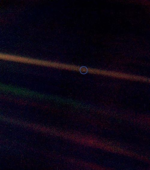 "classicallyintelligent:  From this distant vantage point, the Earth might not seem of any particular interest. But for us, it's different. Consider again that dot. That's here. That's home. That's us. On it everyone you love, everyone you know, everyone you ever heard of, every human being who ever was, lived out their lives. The aggregate of our joy and suffering, thousands of confident religions, ideologies, and economic doctrines, every hunter and forager, every hero and coward, every creator and destroyer of civilization, every king and peasant, every young couple in love, every mother and father, hopeful child, inventor and explorer, every teacher of morals, every corrupt politician, every ""superstar,"" every ""supreme leader,"" every saint and sinner in the history of our species lived there – on a mote of dust suspended in a sunbeam. The Earth is a very small stage in a vast cosmic arena. Think of the rivers of blood spilled by all those generals and emperors so that in glory and triumph they could become the momentary masters of a fraction of a dot. Think of the endless cruelties visited by the inhabitants of one corner of this pixel on the scarcely distinguishable inhabitants of some other corner. How frequent their misunderstandings, how eager they are to kill one another, how fervent their hatreds. Our posturings, our imagined self-importance, the delusion that we have some privileged position in the universe, are challenged by this point of pale light. Our planet is a lonely speck in the great enveloping cosmic dark. In our obscurity – in all this vastness – there is no hint that help will come from elsewhere to save us from ourselves. The Earth is the only world known, so far, to harbor life. There is nowhere else, at least in the near future, to which our species could migrate. Visit, yes. Settle, not yet. Like it or not, for the moment, the Earth is where we make our stand. It has been said that astronomy is a humbling and character-building experience. There is perhaps no better demonstration of the folly of human conceits than this distant image of our tiny world. To me, it underscores our responsibility to deal more kindly with one another and to preserve and cherish the pale blue dot, the only home we've ever known.- Carl Sagan speech at Cornell University, October 13, 1994. Picture taken by Voyager 1 spacecraft from a record distance of about 6 billion kilometers (3.7 billion miles) from Earth"