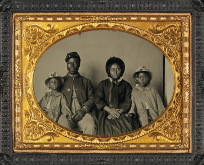 Black Civil War Union soldier with his family, 1863, ambrotype.