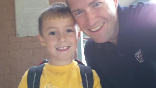The Boy and I at his school. He's a very thoughtful kid and is good at sharing… especially his cold. Thanks, buddy!