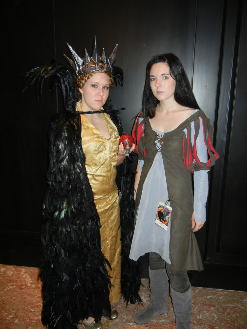 The only real full-on shot of our SWaTH costumes, debuted at D*C this year. The costumes were both fully crafted by us. Thor made the amazing feather cloak and her crown and dress while I drafted my own pattern for Snow's outfit. Didn't have as much time as I wanted to work on it…missing a lot of the fine detailing and trim that made me love the costume in the first place…but some specs: -outer green dress is hand dyed faux suede with red suede lining -under dress has a hand-weathered hem that I dirtied using brake dust (yup, as in right from the hubcap) and coffee grounds. Didn't show near well enough in the photos.  If anyone sees any more pics of us from the con floating around, would you mind shooting a link my way?
