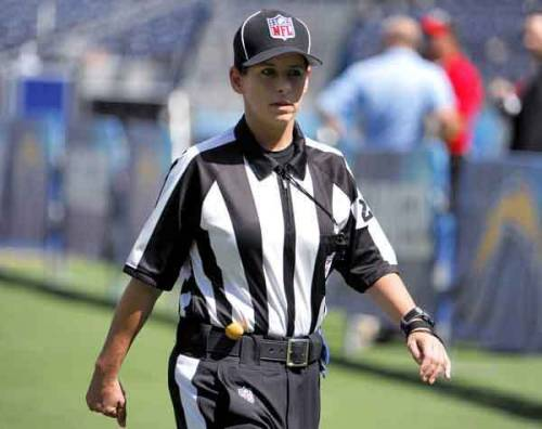NFL's 1st female official makes regular season debut AP:  Shannon Eastin has made NFL history. Eastin was the line judge in Sunday's St. Louis Rams-Detroit Lions game, making her the first woman to be an official in a regular-season game. She is among the replacement officials hired by the league while the regular officials are locked out. Replacement officials are working games for the first time in 11 years.  Photo: Shannon Eastin takes the field in San Diego for her debut as an NFL official during a preseason game between the Packers and Chargers on Aug. 9. (Denis Poroy / Associated Press via LA Times)