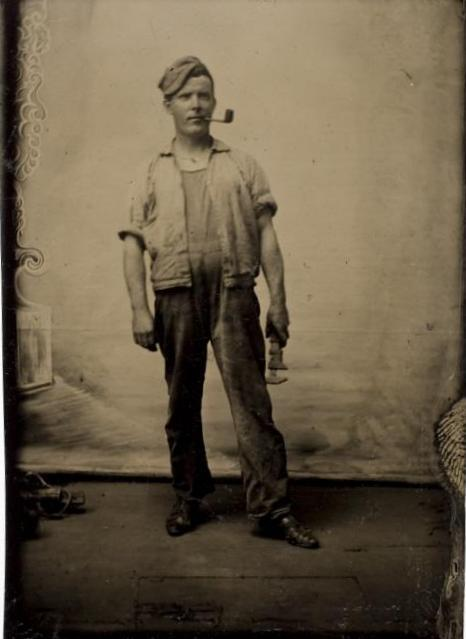 ca. 1875, [tintype portrait of a mechanic with a pipe]  via the International Center of Photography