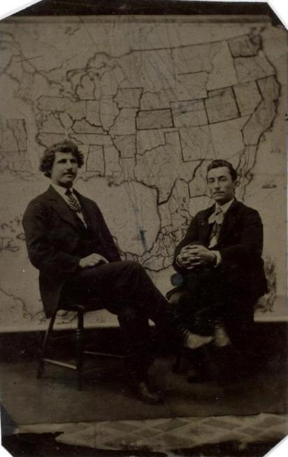 ca. 1875, [tintype portrait of two gentlemen sitting in front of a U.S. states and territories map] via the International Center of Photography