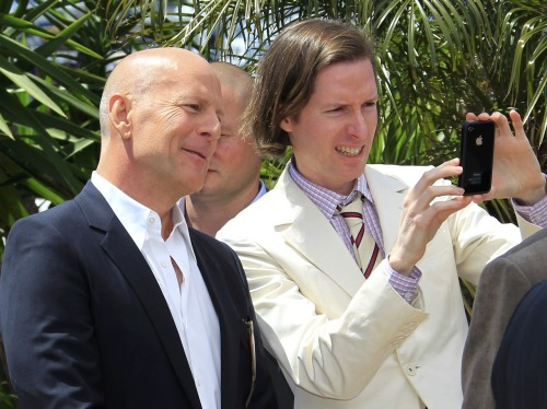 Part 2 of Wes Anderson loves his Iphone. Cannes 2012. Bruce Willis is pretending to be impressed with the Instagram effects Wes has been experimenting with.