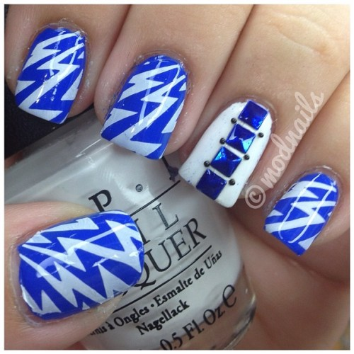 "modnails:  Blue is Sally hansen's ""Pacific Blue""White on my accent nail is OPI's ""Alpine Snow""White used for stamping is Konad's white polishI got the blue studs at www.dollarnailart.comFor the lightning bolts I used bundle monster's plate from their new collection BM 305You can purchase the plates at www.bundlemonster.com or amazon. Follow me on instagram @modnails<3"