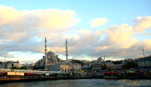 "caterpillarcowboy:  Photo of New Mosque in Istanbul. New Mosque actually isn't very new (construction began in 1597). Like all mosques, the 5-times-a-day prayer call (ezan in Turkish) is broadcast from the minarets. Really adds to feeling of ""oh hey, I'm not in NYC anymore"".  After a couple of days in Istanbul, you get used to the day being divided up by the call to prayer, which, thanks to the hills and the maniacal hand that drew streets on them, combines (and competes) from mosques around the city. Istanbul is definitely at the top of my list of cities that need another, longer visit."