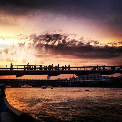 #millenniumbridge earlier today at #sunset #london #bridge #people #sky #clouds #cloudporn #skyporn #silhouette #sun #reflection   (Taken with Instagram)