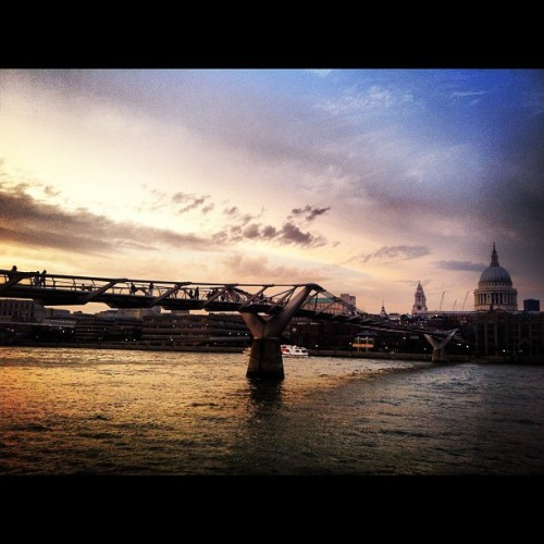 #millenniumbridge and #stpauls at #sunset #london #silhouette #people #sky #skyporn #reflection #sun #clouds #cloudporn #bridge #river #thames (Taken with Instagram)