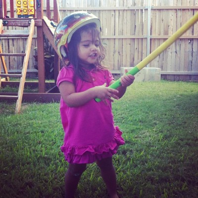 "Lilly is wearing a helmet swinging a golf club and saying ""hyeaaaah!""  (Taken with Instagram)"
