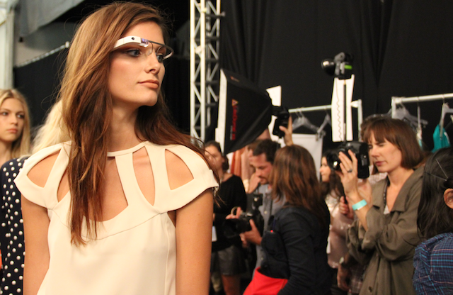 (via Google Glass Graces the Runway at New York Fashion Week)  Look at this photo… its Brad Pitt wearing blue Tooth… You cant make these things look cool… Keep working on it Google.