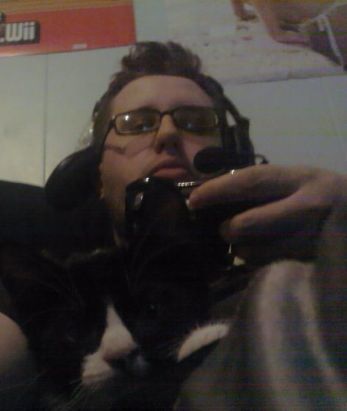 Batman and I playing some Xbox.My broke headset and all.
